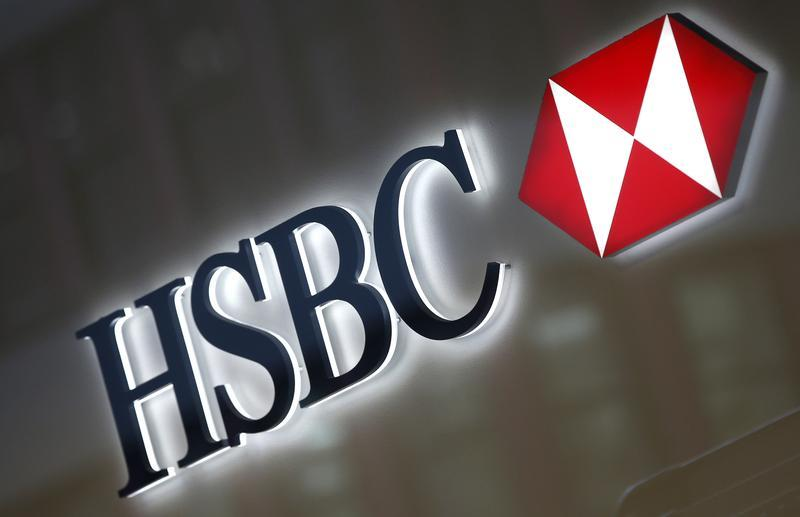 A HSBC logo is seen above the entrance to a HSBC bank branch in midtown Manhattan in New York City, December 11, 2012. HSBC has agreed to pay a record $1.92 billion fine to settle a multi-year probe by U.S. prosecutors, who accused Europe's biggest bank of failing to enforce rules designed to prevent the laundering of criminal cash. REUTERS/Mike Segar (UNITED STATES - Tags: BUSINESS CRIME LAW LOGO) - RTR3BG86